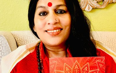 Acharya Shunya holding her new book with title Sovereign Self